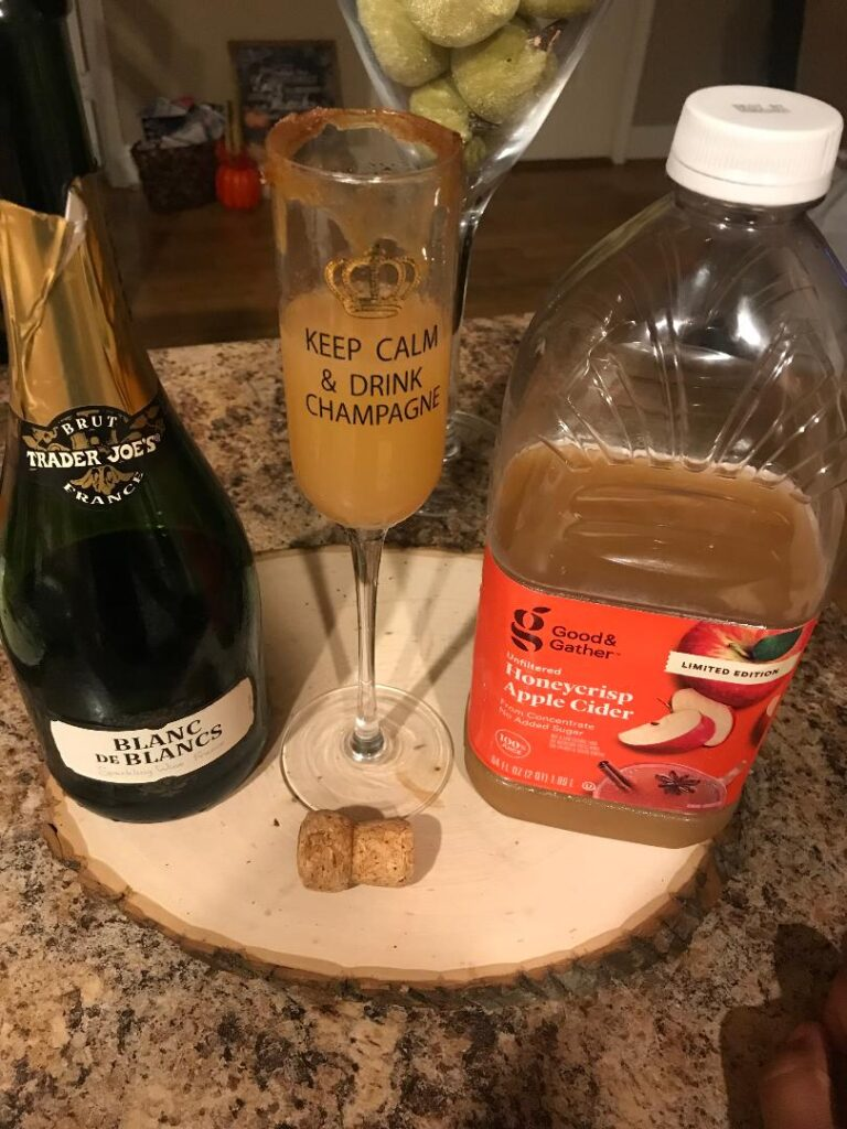 Some Honeycrisp Apple Cider and Blanc de Blancs wine make for the perfect tall glass of Apple Cider Mimosas during Autumn